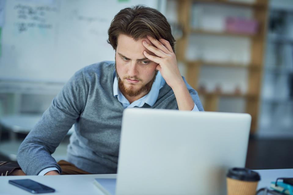 frustrated worker, employee well-being, mental health, employer benefits, PTO, MetLife, flexible work, remote work
