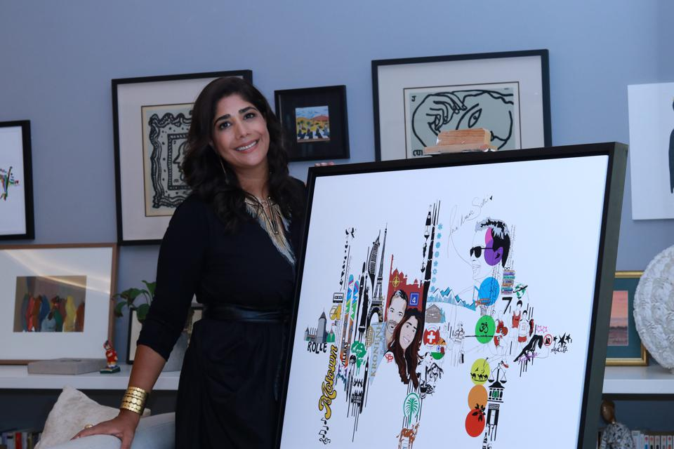 Amrita Sethi with a print of one of her Voice Note Art works