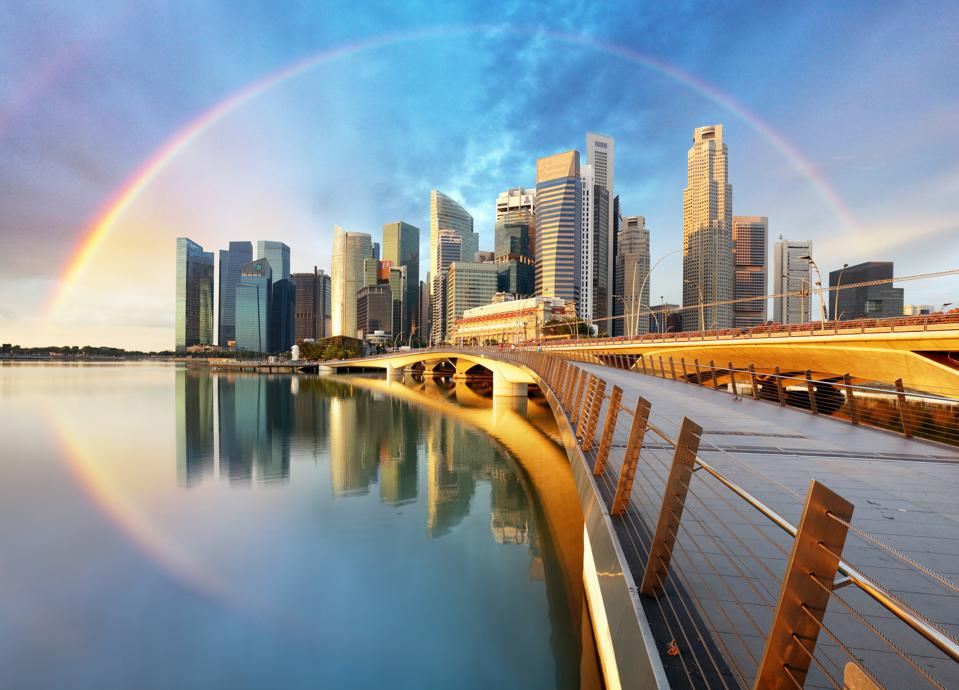 Singapore business district with rainbow