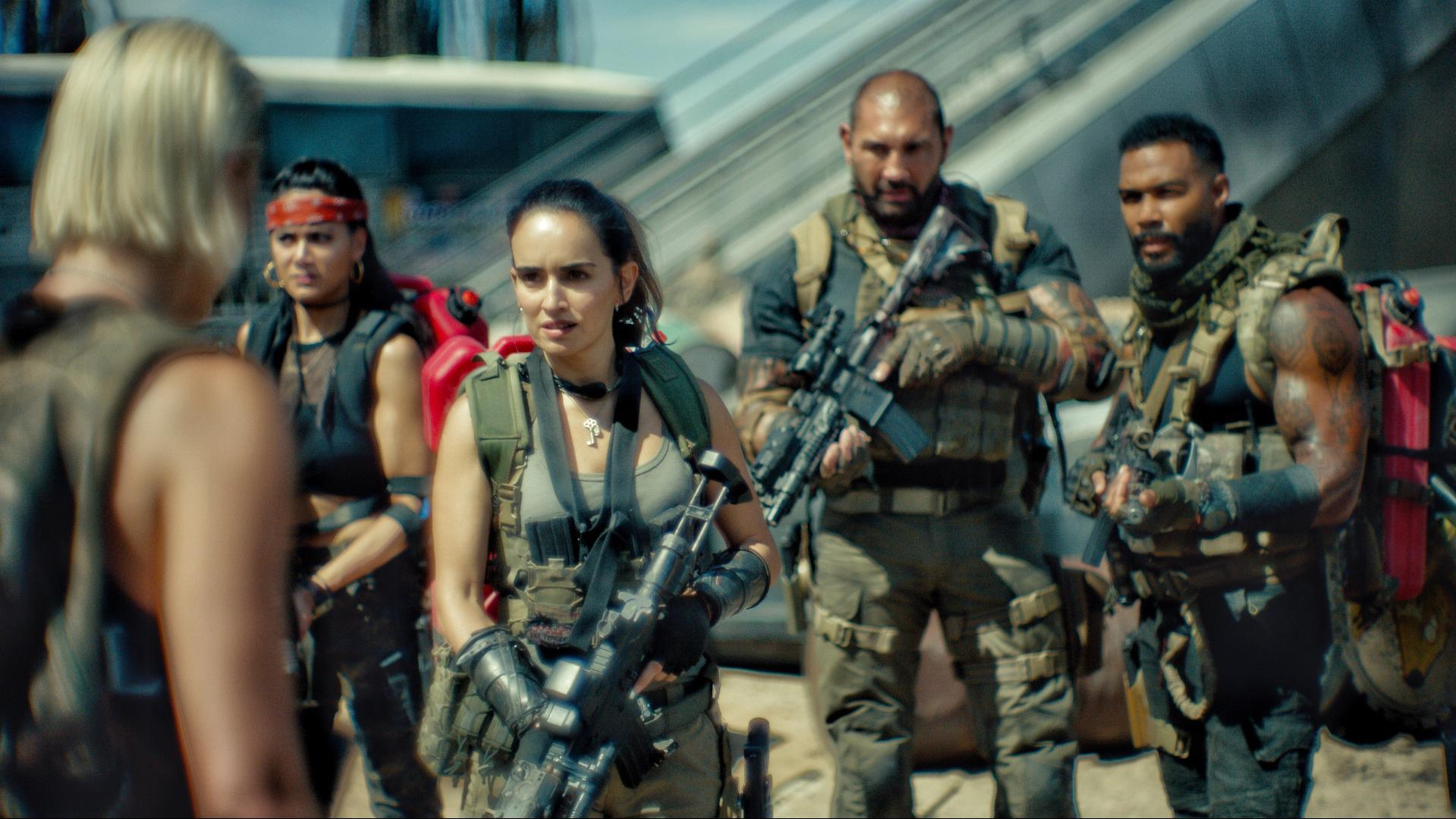 ARMY OF THE DEAD - (L-R) NORA ARNEZEDER as LILLY, SAMANTHA WIN as CHAMBERS, ANA DE LA REGUERA as CRUZ, DAVE BAUTISTA as SCOTT WARD and OMARI HARDWICK as VANDEROHE.