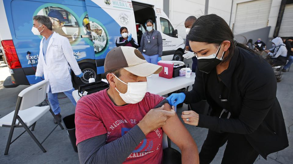 The city of Vernon demonstrates the use of special refrigeration to store Pfizer COVID-19 vaccine as they city is using a van to operate a mobile clinic and provide vaccination to frontline workers at various food and industrial plants in the city.