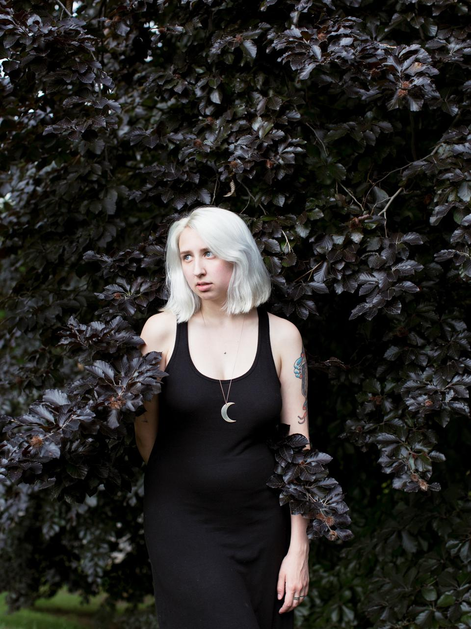 A witch standing in a bush