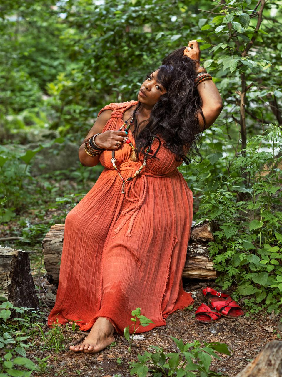 A witch in an orange dress