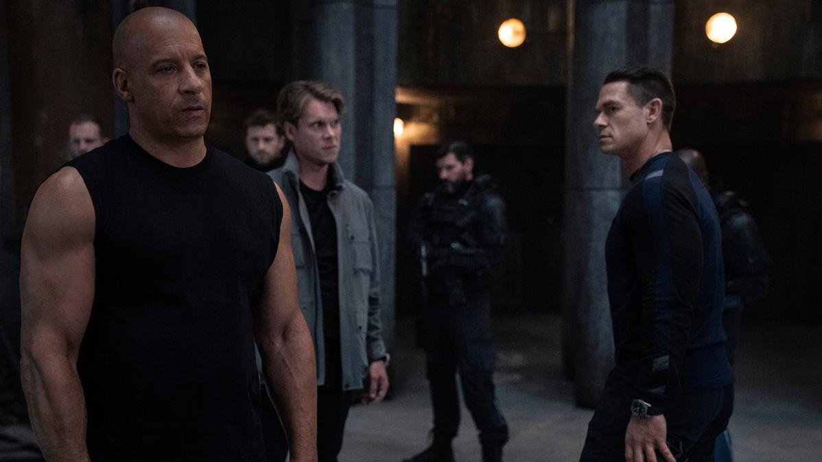 (from left) Dom (Vin Diesel), Otto (Thue Ersted Rasmussen, in the gray jacket) and Jakob (John Cena) in ″F9,″ directed by Justin Lin.