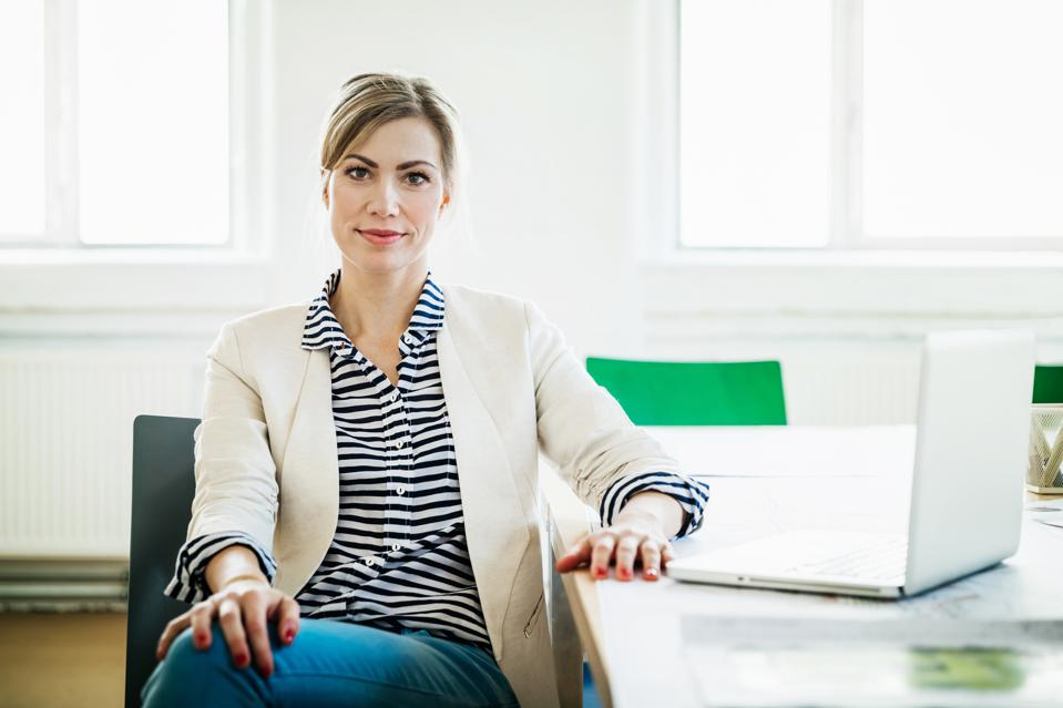 Portrait Of Business Owner At Conference Table