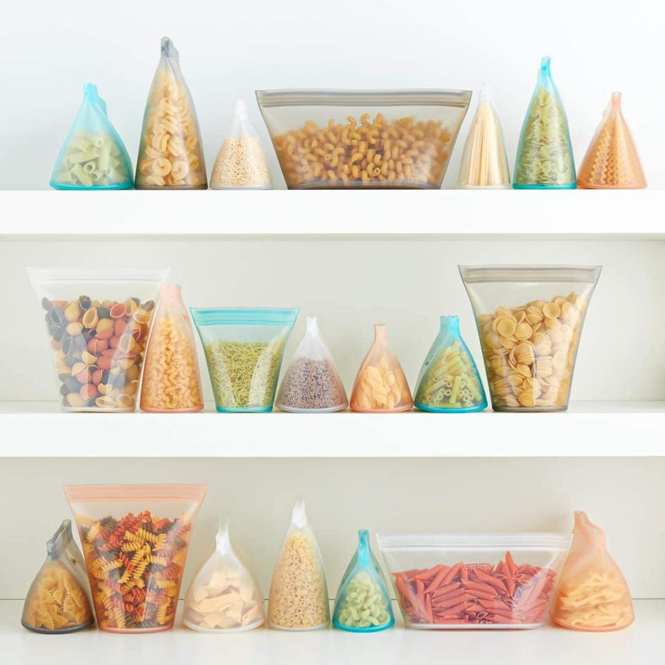 Reusable Ziploc bags by Zip Top shown holding snacks lined up in a pantry
