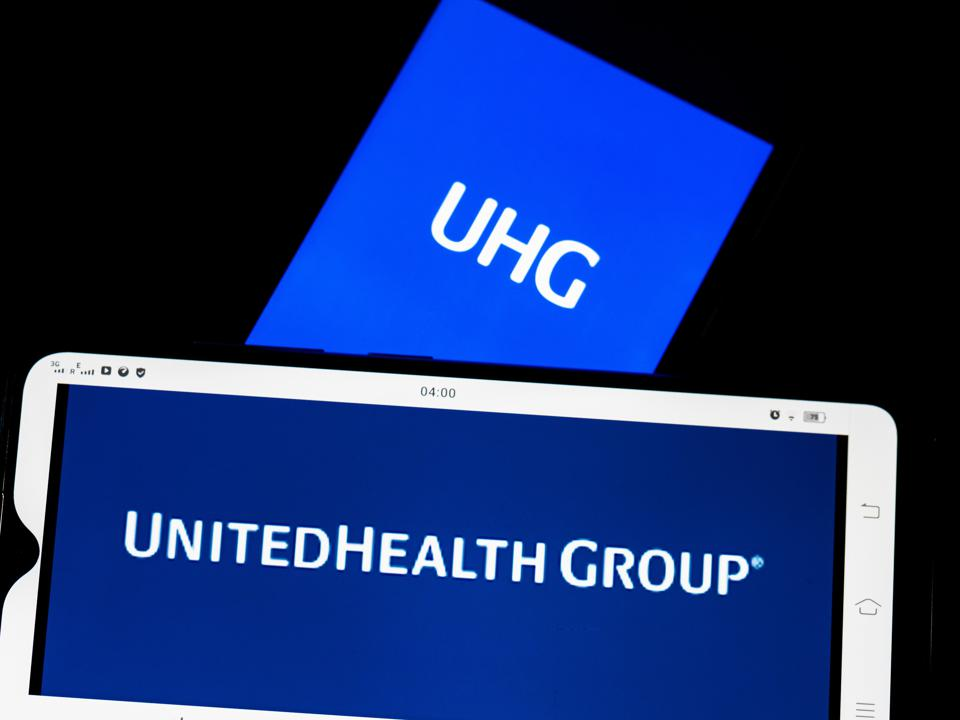 In this photo illustration United Health Group Inc. logo...