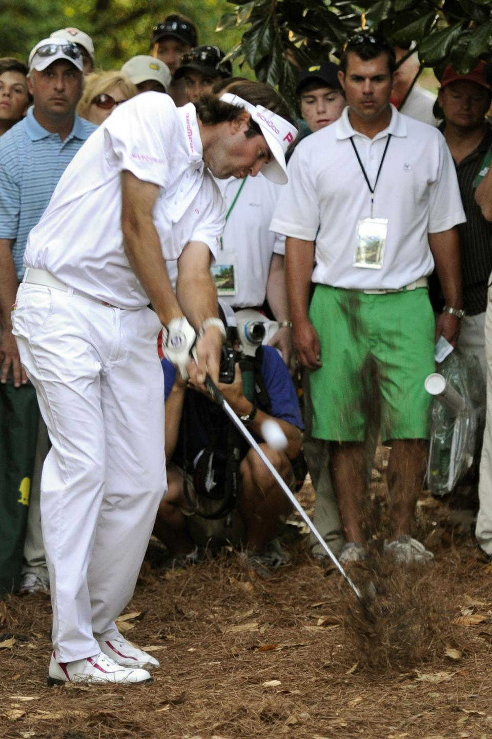 Bubba Watson of the United States hits out of the woods on his way to win the 76th Masters