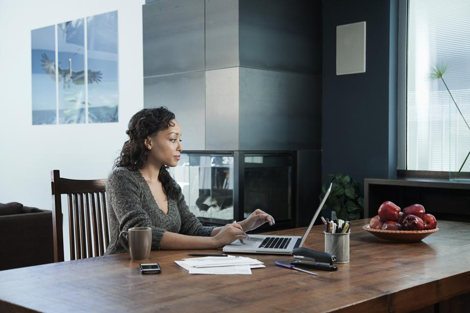 Black businesswoman working from home