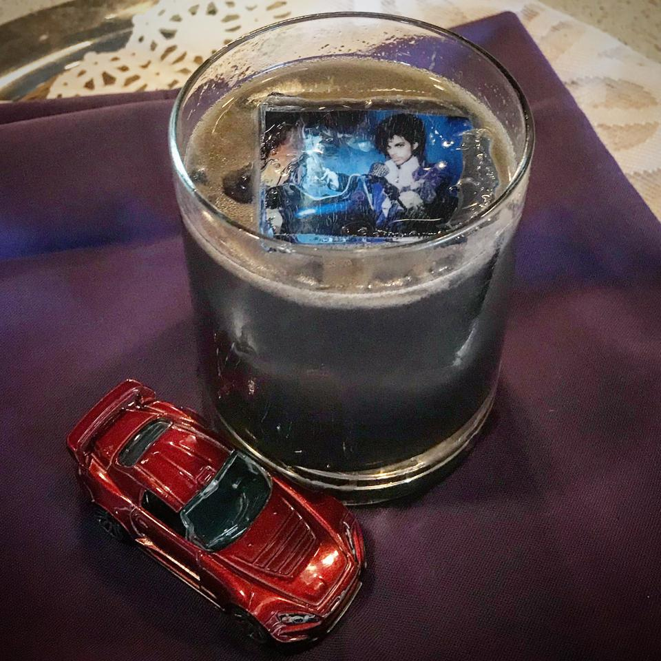Corpse Reviver #U cocktail with Prince ice garnish next to little red Corvette