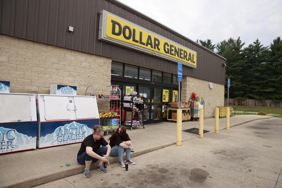 Workers at the Dollar General store taking a break across...