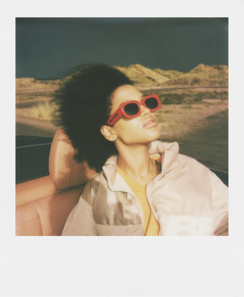 polaroid photo woman in desert