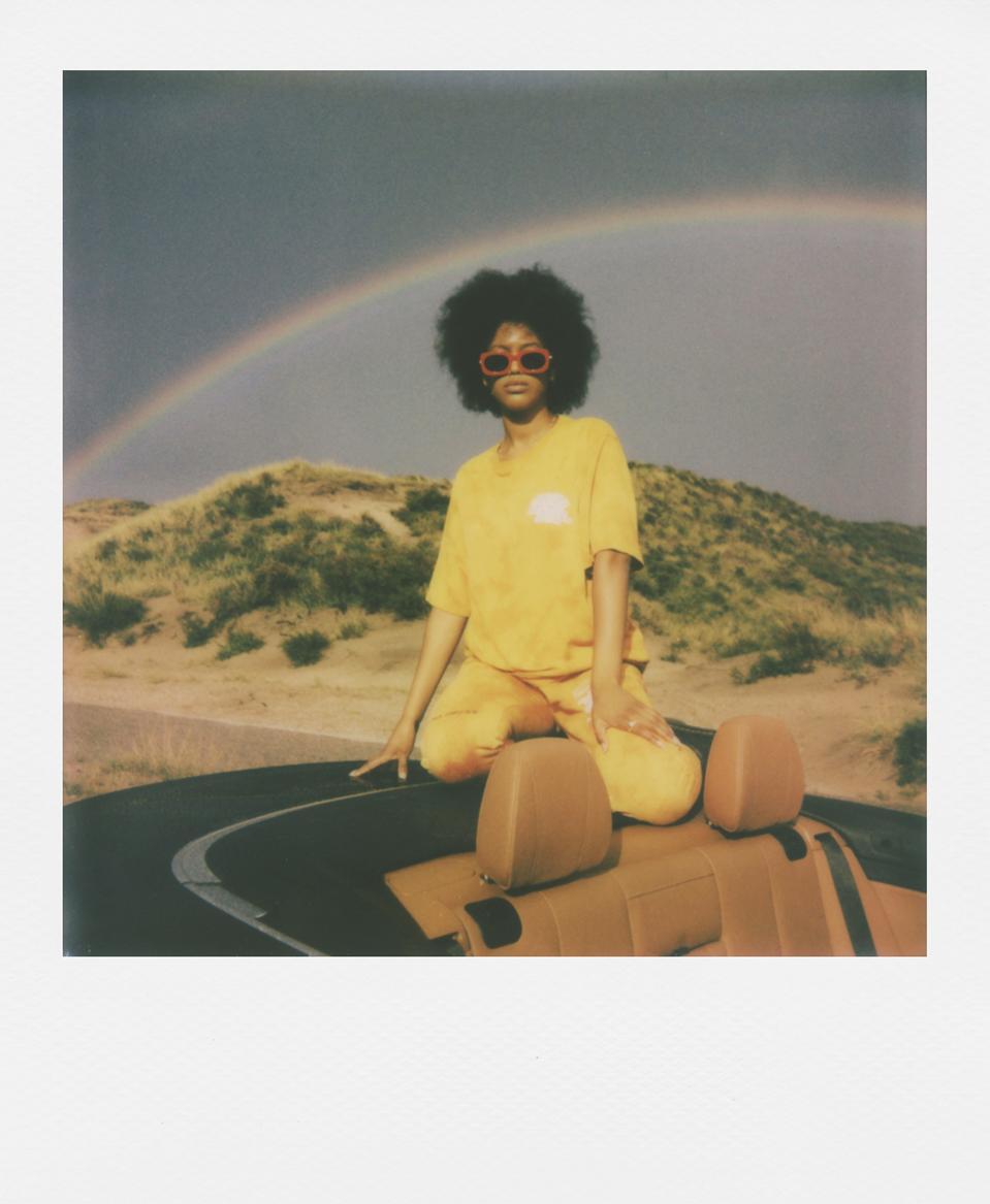woman in desert rainbow