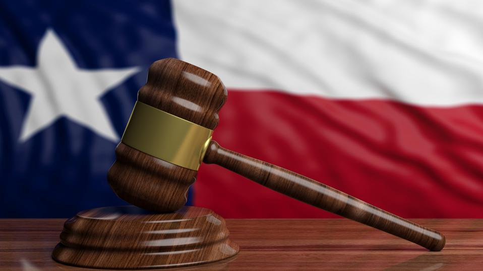 Judge or auction gavel on Texas US America flag background. 3d illustration