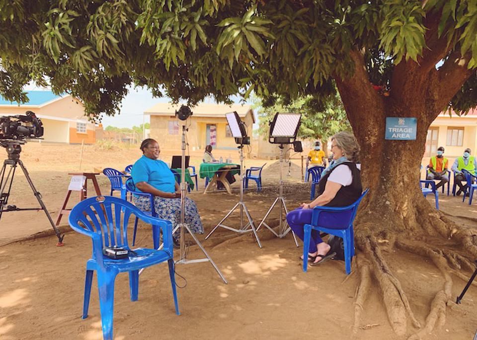 In Uganda's Bidi Bidi refugee settlement, UNICEF Health Specialist Dr. Eva Kabwongera (left) and NBC's Cynthia McFadden discuss the challenges of reaching remote areas of the country with COVID-19 vaccines.