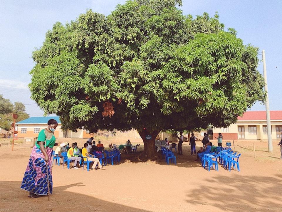 Refugee health workers receive COVID-19 vaccinations in Uganda's Bidi Bidi refugee settlement.