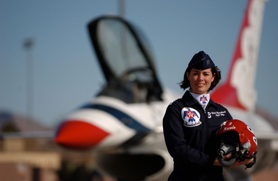 Colonel Nicole Malachowski served as a mission-ready fighter pilot in three operational F-15E squadrons and accumulated over 2,300 flight hours, including 188 hours in combat.