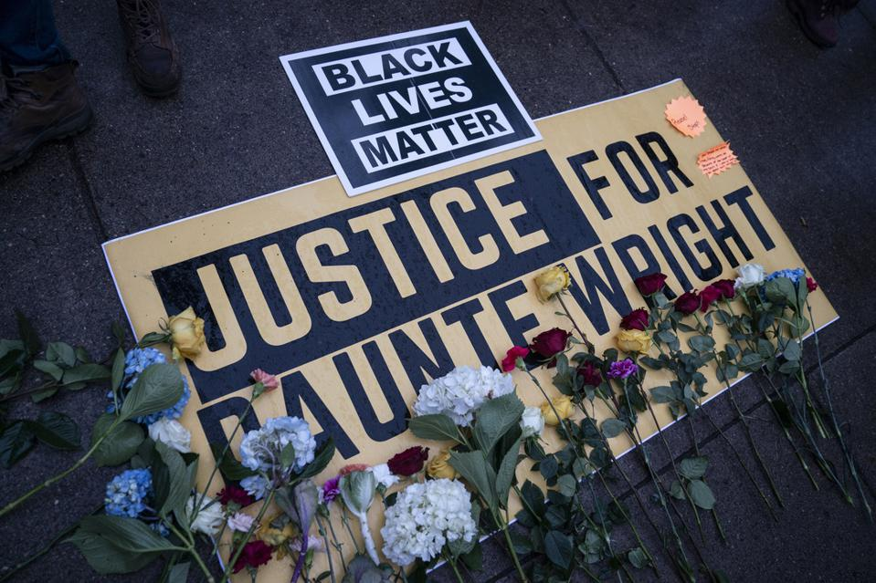 Flowers on a Black Lives Matter memorial for Daunte Wright