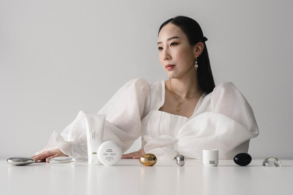 Superegg founder Erica Choi poses with skincare products.