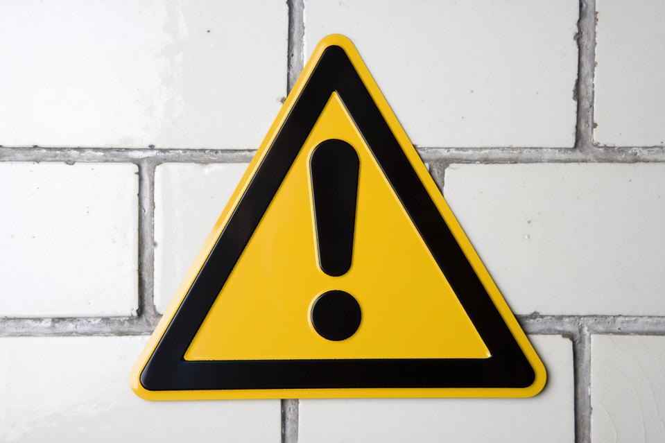 ?Hazard? warning sign