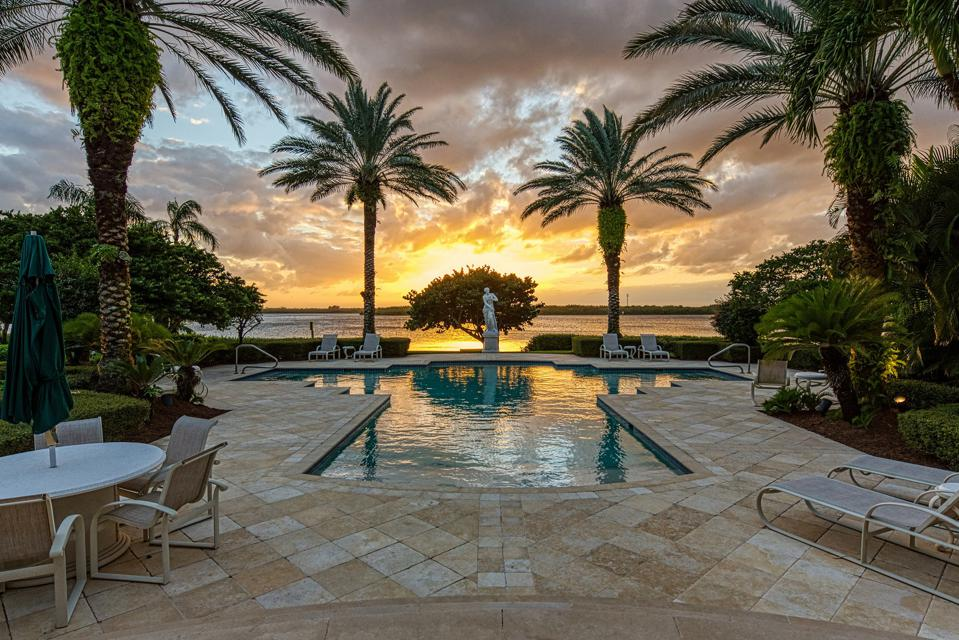 swimming pool and waterway view from 131 Gem Island Drive Vero Beach, FL, United States
