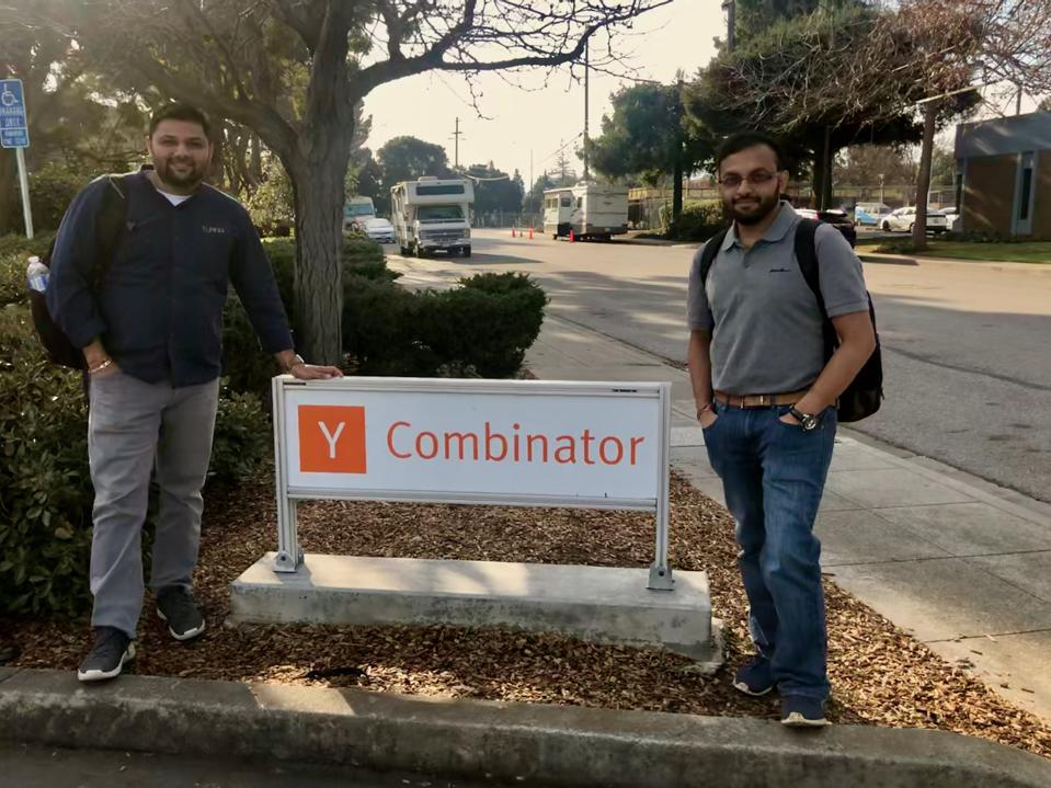 Turing Labs founder's Manmit Shrimali and Ajith Govind in front of Y-Combinator's sign