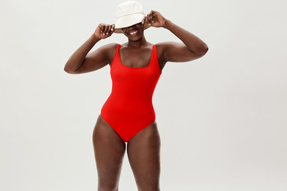 Sustainable swimwear: woman in red bathing suit