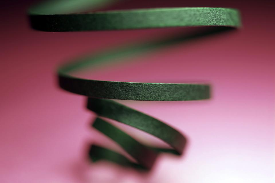 Curled Black Ribbon With Pink Background