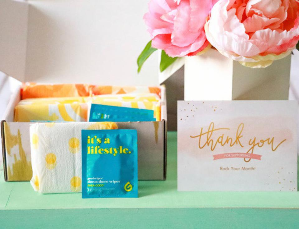 A picture of maxi-pads and flowers.