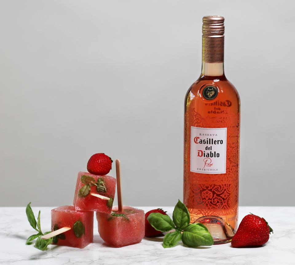 a bottle of rose and frozen treats