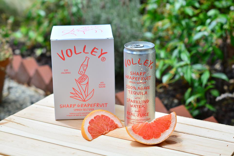 a canned drink and sliced grapefruit
