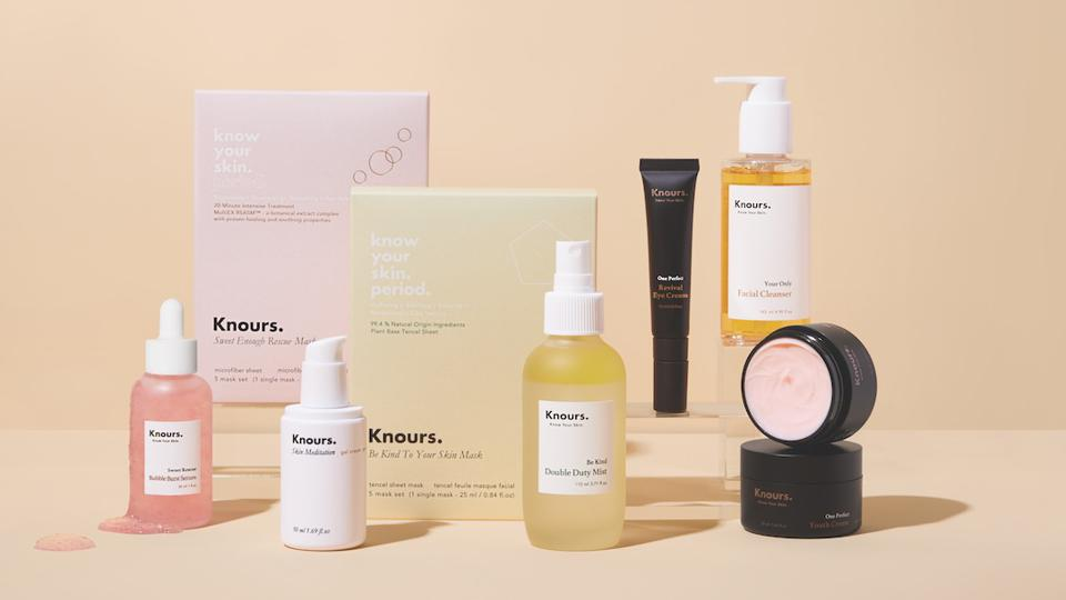 A selection of Knours skincare products against a tan background.