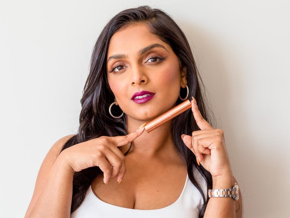 Deepica Mutyala holds the hue stick