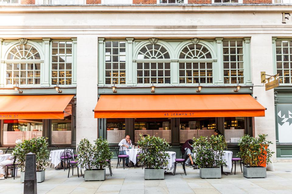 orange awnings and terrace with shrubs