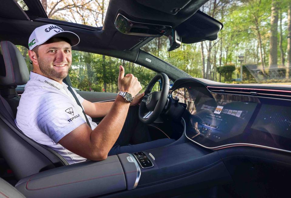 John rahm sits in a Mercedes SUV