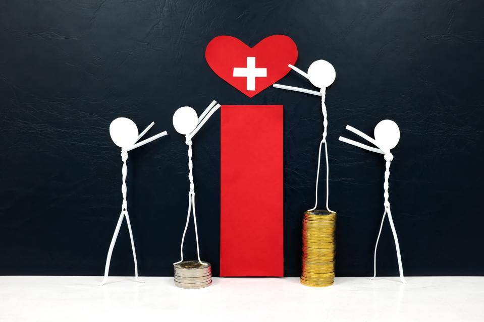 Stick figure reaching for a red heart shape with cross cutout while stepping on stack of coins.