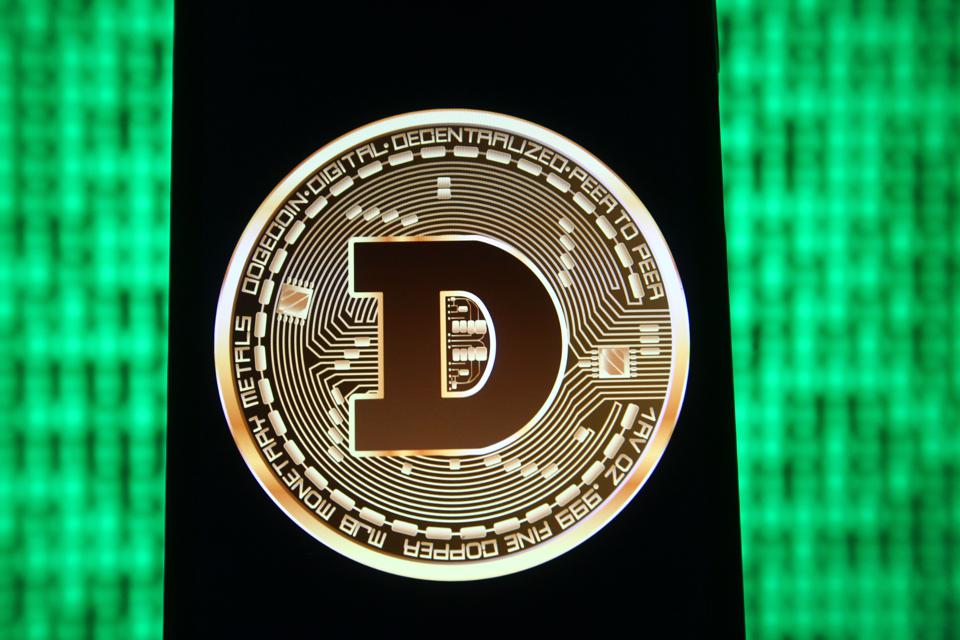 In this photo illustration a Dogecoin sign of a digital...