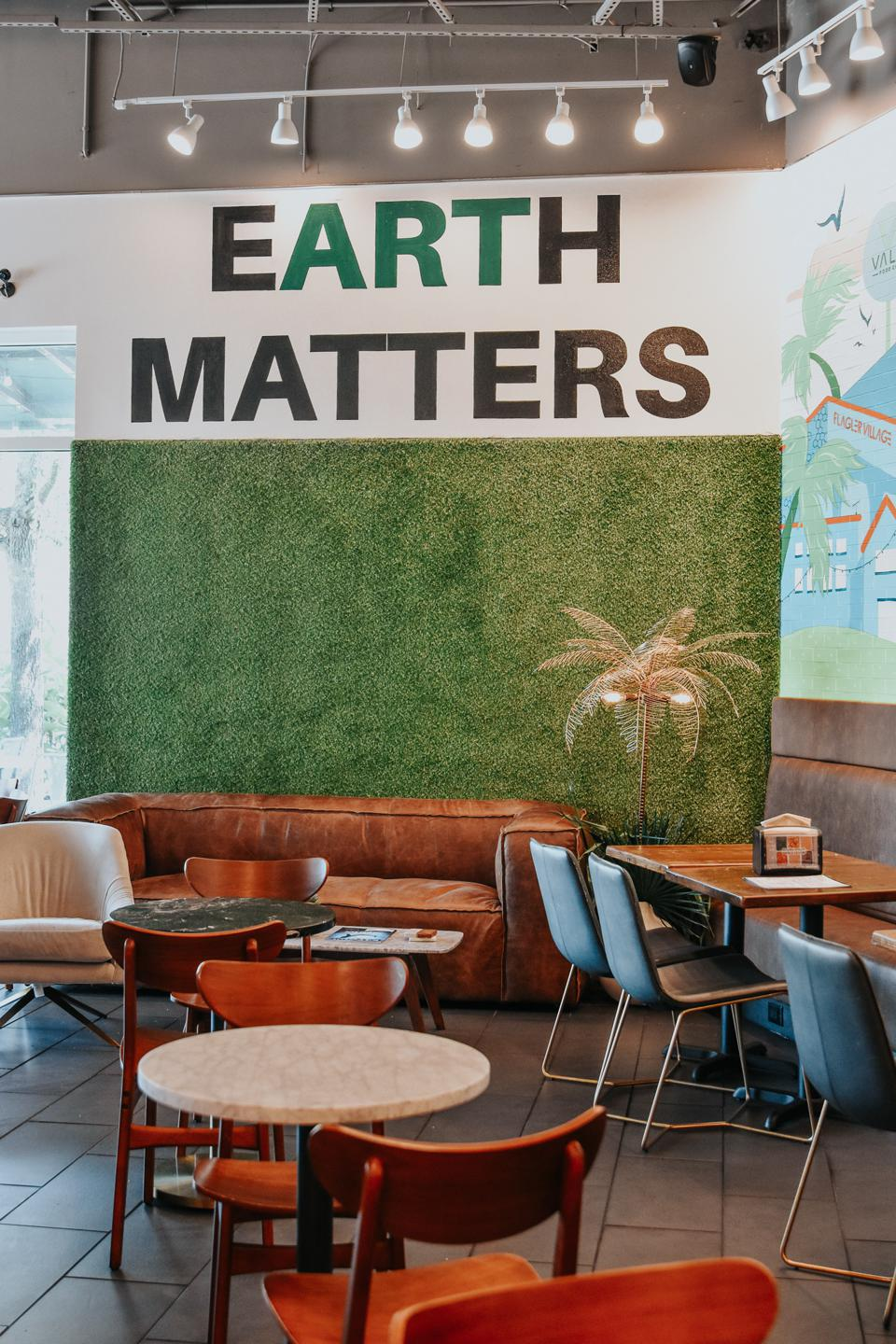 inside Vale Food Co with a mural that reads ″Earth Matters″