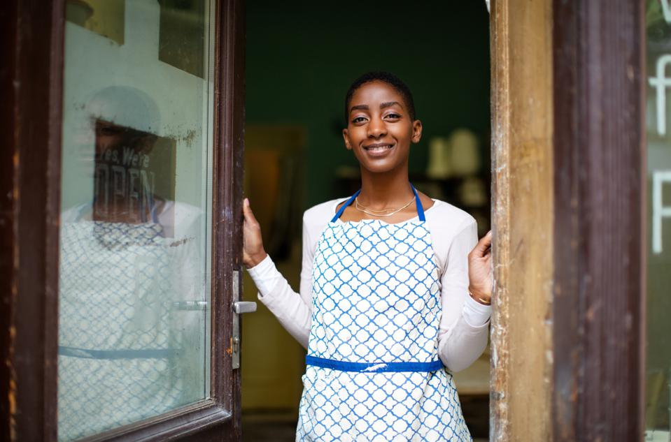 Happy pottery studio owner at the entrance door