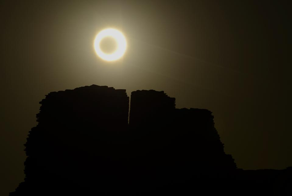 The Moon appears to cover the sun during an annular eclipse of the Sun on May 20, 2012 as seen over Chaco Culture National Historical Park in Arizona. The same kind of eclipse will be visible from the same location in 2023.