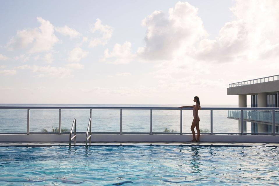 Woman at Carillon Miami pool