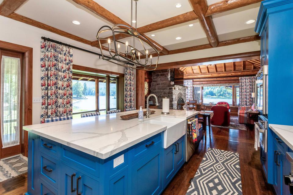 kitchen and living room inside log cabin cornelius kelley swan lake copper king 13592