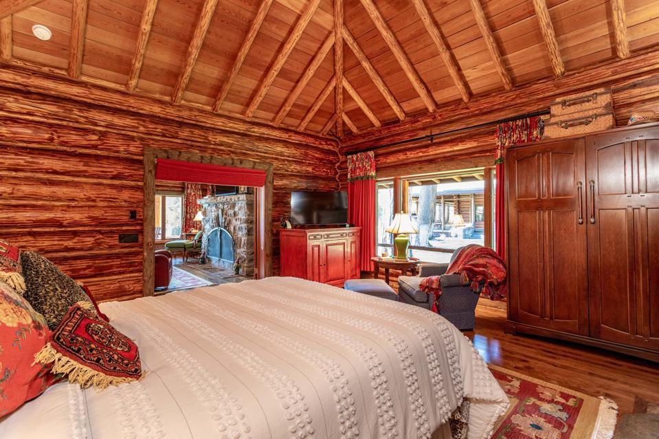 bedroom inside swan lake log home 13592 River Run Loop Bigfork, Montana, USA