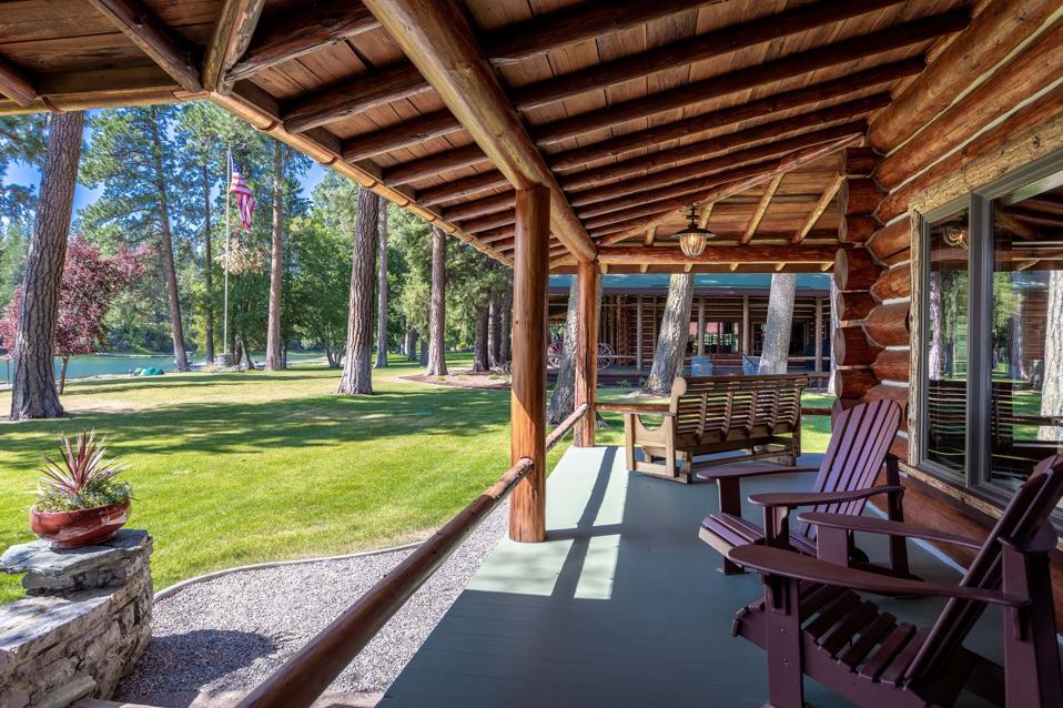 swan lake log home wraparound balcony 13592 River Run Loop Bigfork, Montana, USA