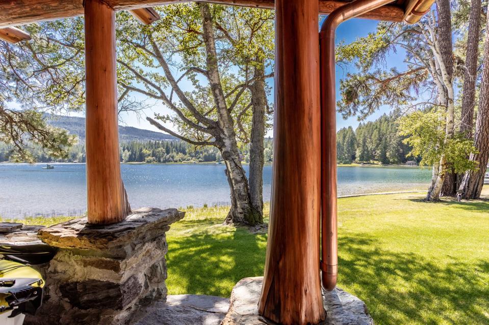 porch swan lake log home cornelius kelley copper baron bigfork montana