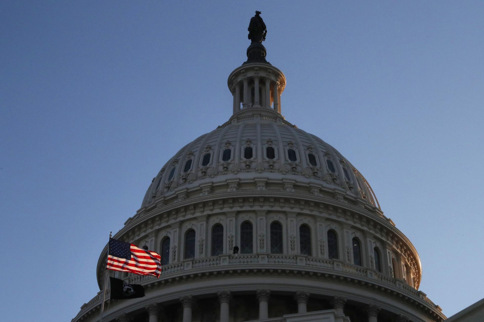 The U.S. Capitol Building And American Flag