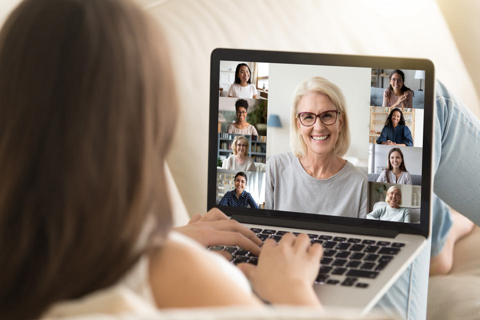 Girl use laptop involved at group videocall with diverse women