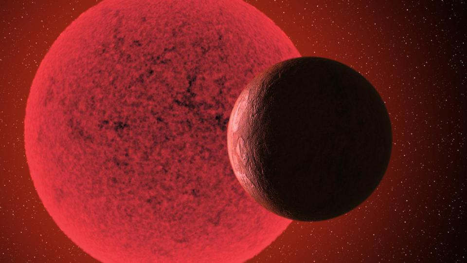 Artistic impression of the super-Earth in orbit round the red dwarf star GJ-740.