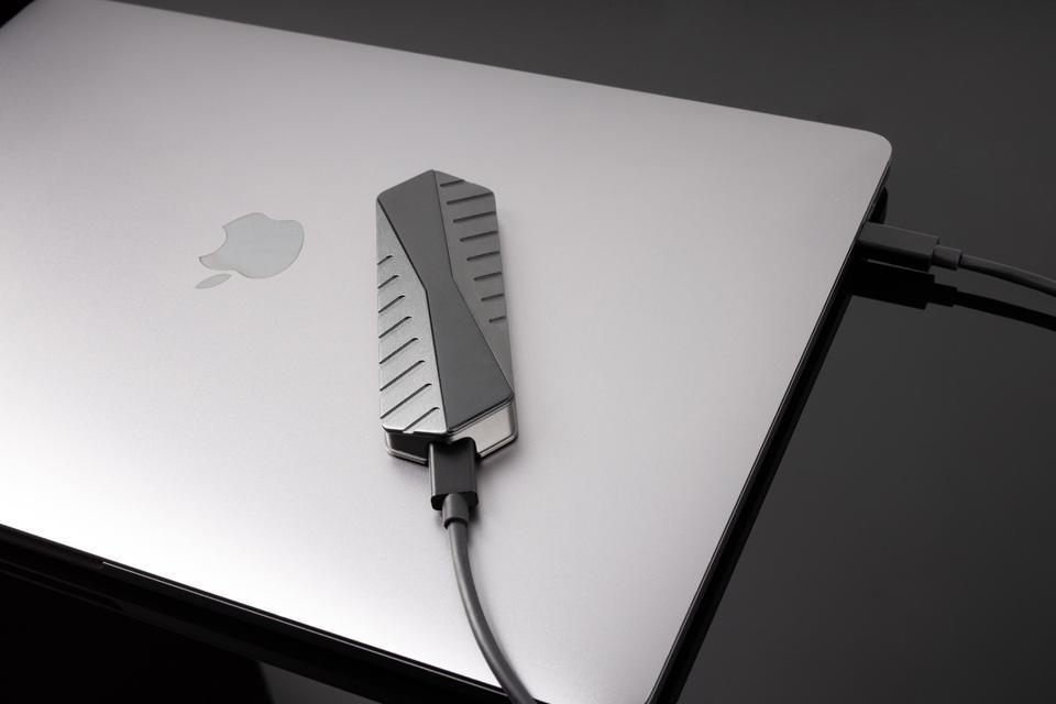 Space Grey GigaDrive on top a MacBook's lid