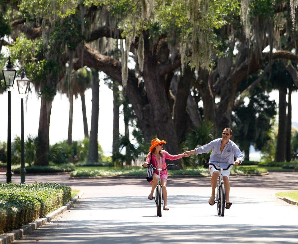 Guest biking at Montage Palmetto Bluff Resort